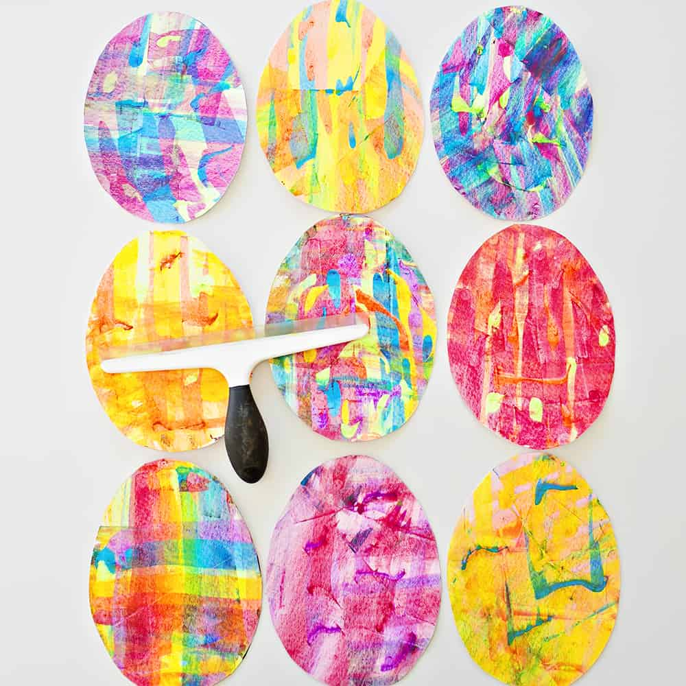 30+ Creative DIY Easter Crafts for Kids rainbow squeegee paint Easter egg art momooze.com online magazine for moms