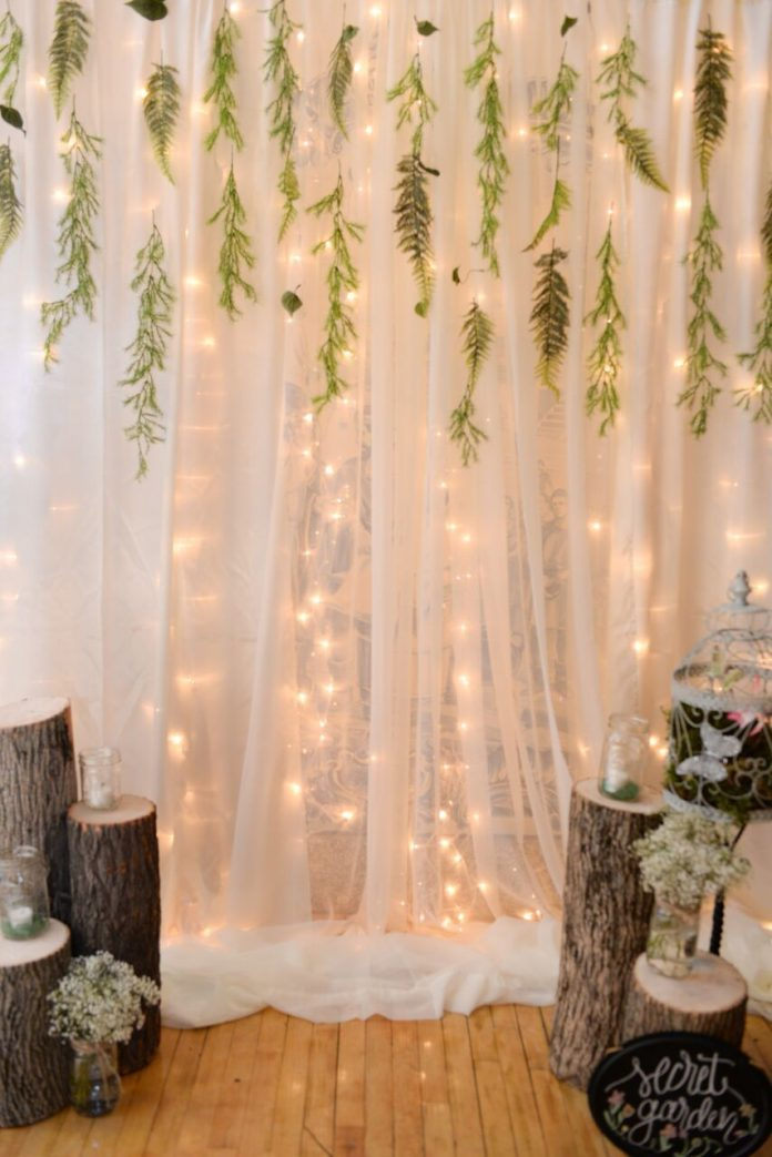 Enchanted Forest Party Theme Ideas for Kids Birthday fairy lights white curtains twigs momooze.com online magazine for moms