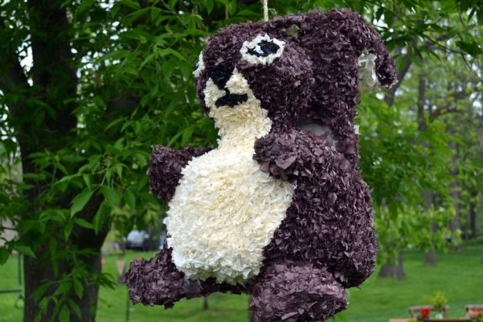 Enchanted Forest Party Theme Ideas for Kids Birthday homemade squirrel pinata momooze.com online magazine for moms