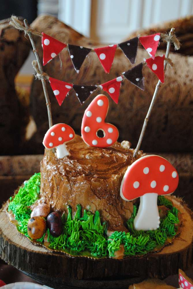Enchanted Forest Party Theme Ideas for Kids Birthday tree stump cake momooze.com online magazine for moms