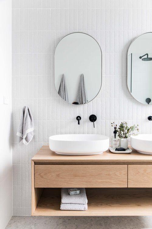 Scandinavian bathroom - feature mirrors with wooden sinks