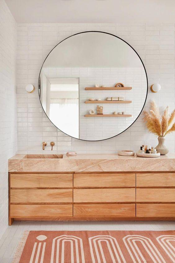 Scandinavian bathroom - statement round mirror with wooden vanity sinks