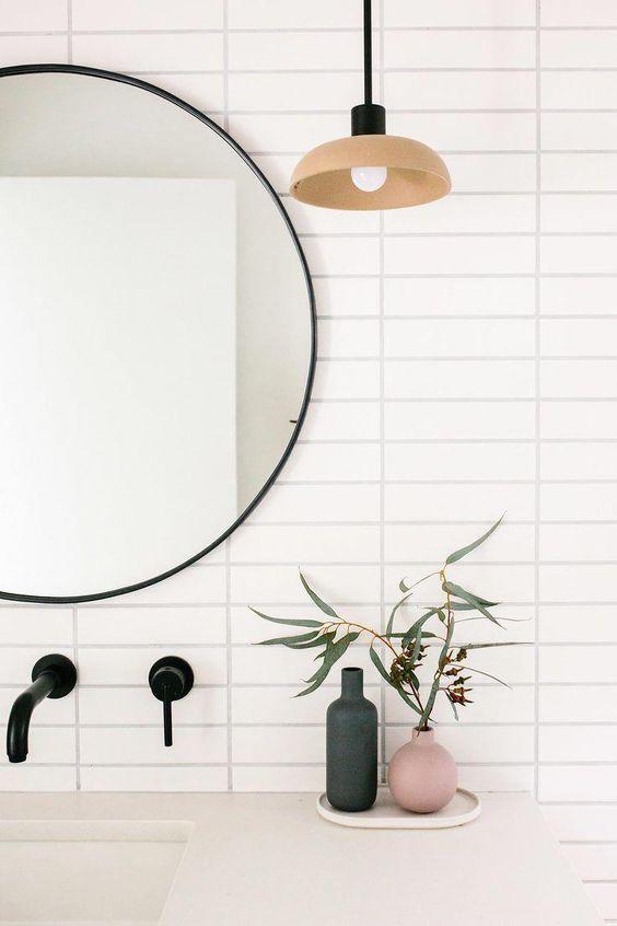 Scandinavian bathroom - statement round black mirror