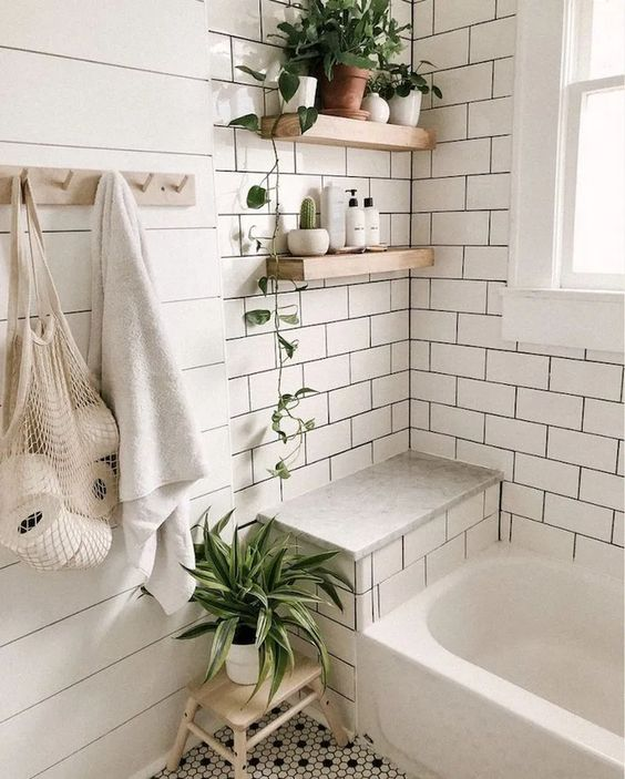 Scandinavian bathroom - white tile bathroom with plants