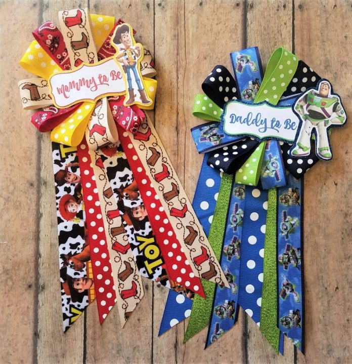 ribbons for mom and dad for baby shower in toy story theme