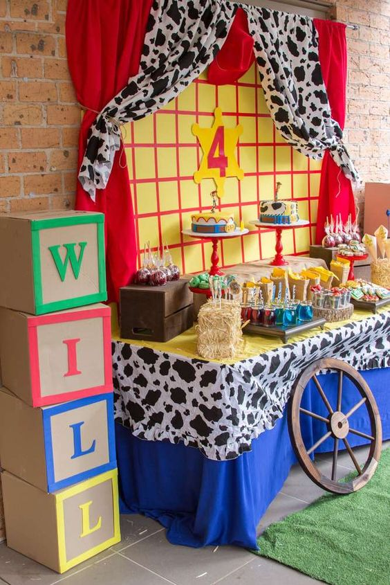 featured table with snacks and food for toy story baby shower party