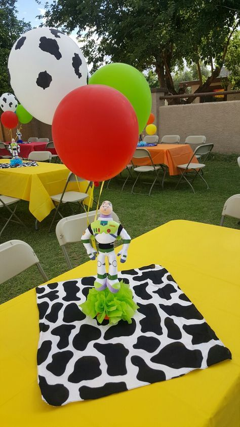 baby shower table outdoors with balloons toy story theme