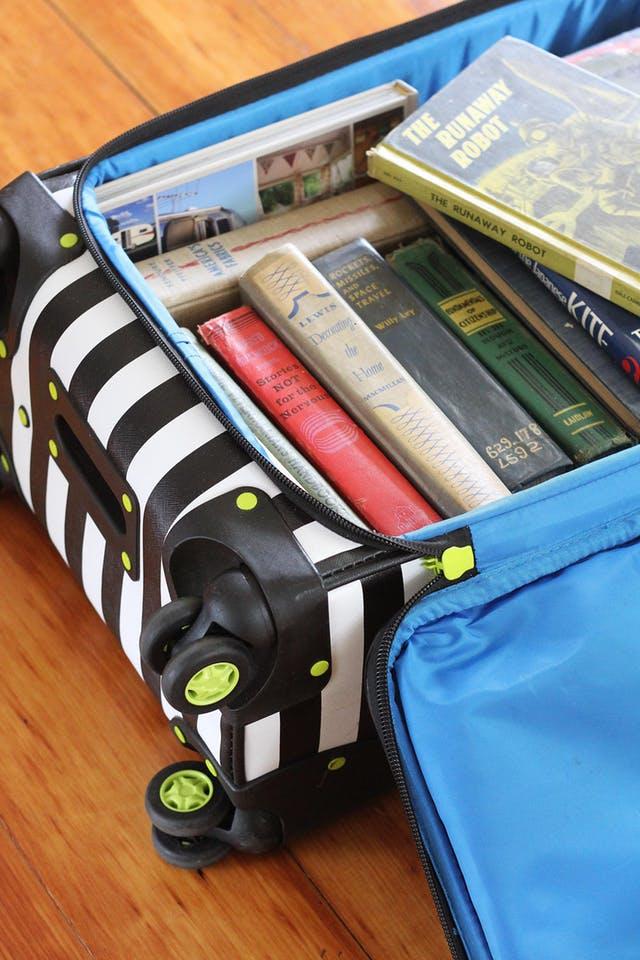 books in suitcases