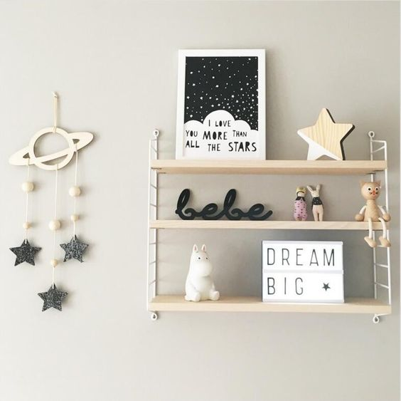 nursery shelf decor above changing table