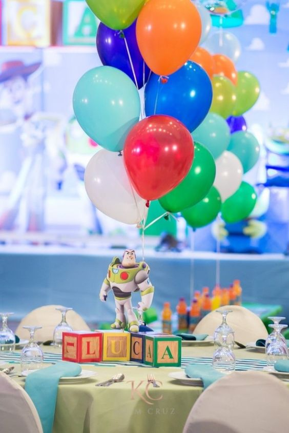 balloons and toy on a toy story baby shower party
