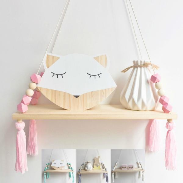 nursery shelf decor above changing table